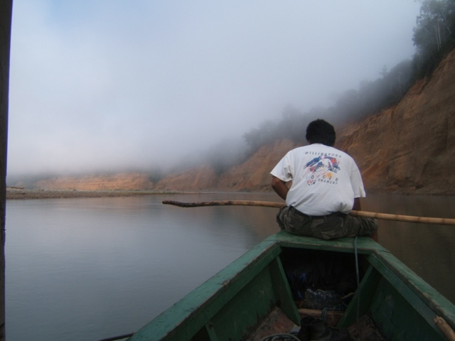 Wilman guiding the boat up the Tuichi river